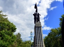 Monument to Komsomol of Uran and the Ascension Church behind