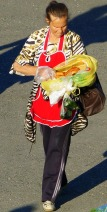 Lady selling food supplies to passengers