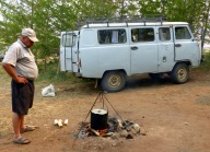 Cooking omul fish straight from the lake