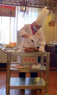 Chef carving roast duck from Qianmen Quanjude Roast Duck Restaurant, Beijing